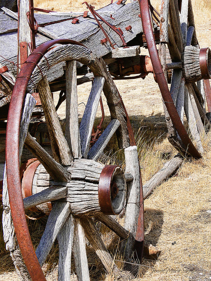 Wheel Photograph - Old Wagon Wheels From Montana by Jennie Marie Schell