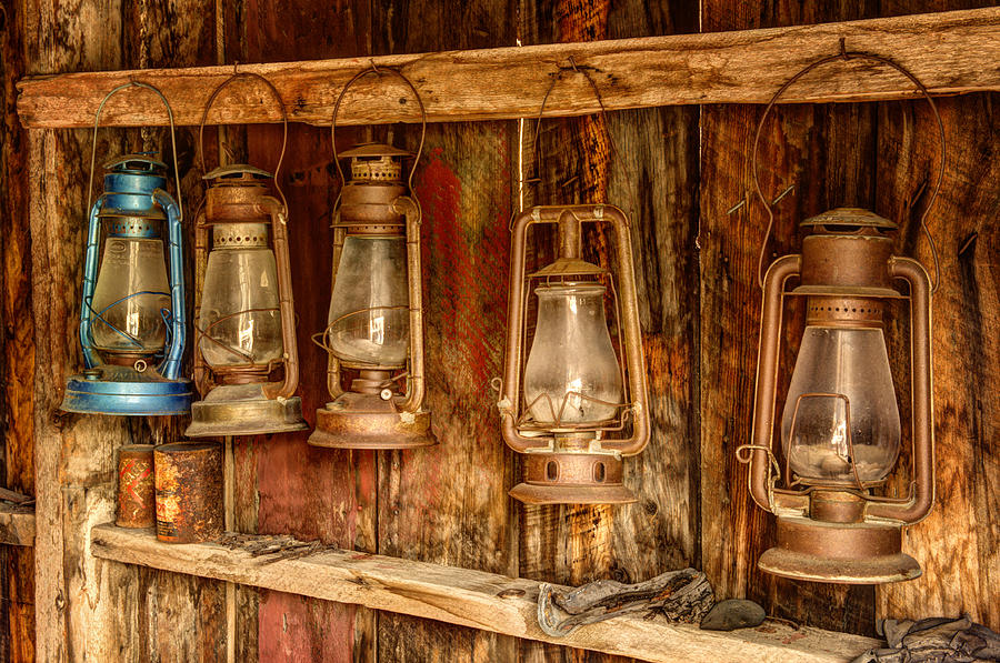 Old Western Lanterns Hanging In A Row Photograph By Kriss
