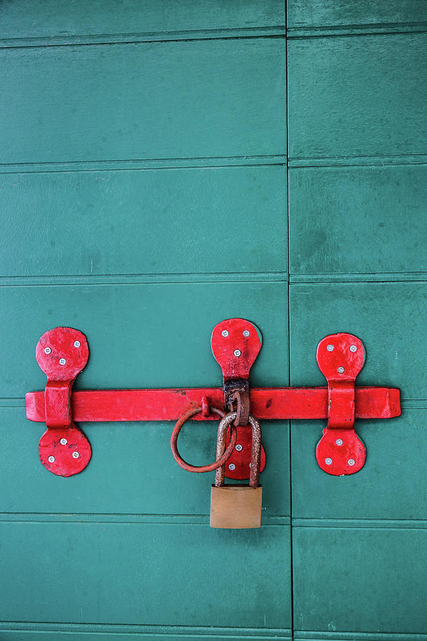 Old Wooden Doors Locked By Rusty Padlock Photograph by Dejan Kolar