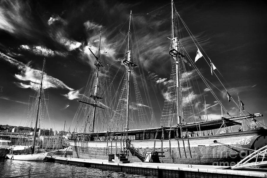 Clouds Photograph - Old World Sailboat by John Rizzuto
