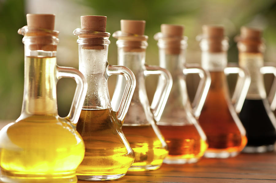 Olive Oil And Vinegar In Bottles On The Photograph by Ralucahphotography.ro