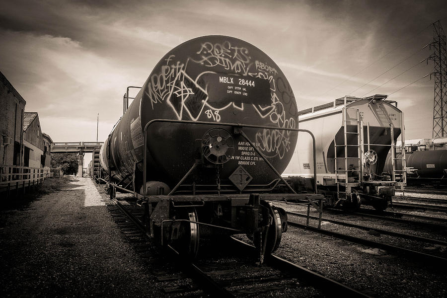 Train Photograph - Ominous Train Under Dark Skies In New Orleans by Louis Maistros