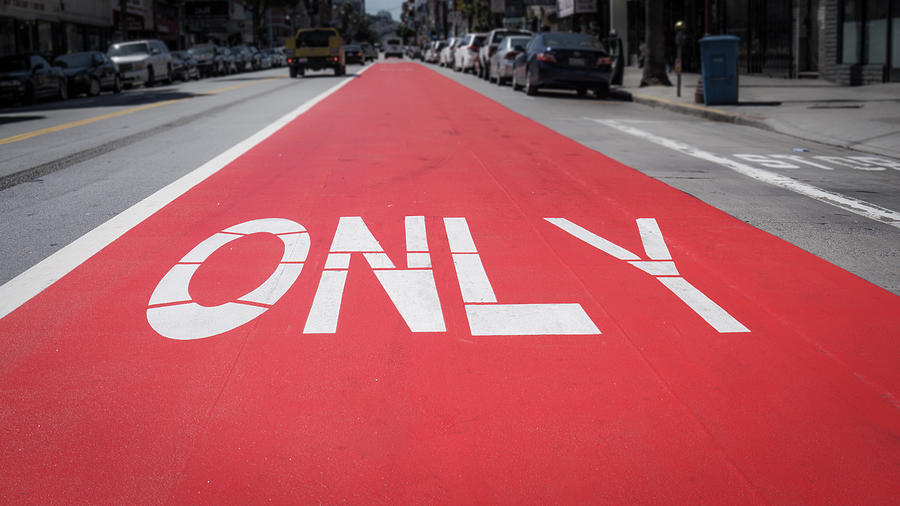Only Sign On Road In City Photograph by Jesse Coleman / EyeEm