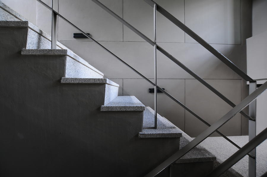 Steps Photograph - Open Stairwell In A Modern Building by Primeimages
