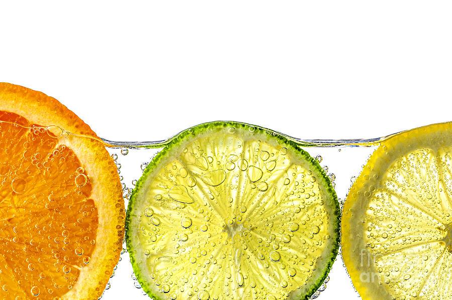 Orange Photograph - Orange Lemon And Lime Slices In Water by Elena Elisseeva
