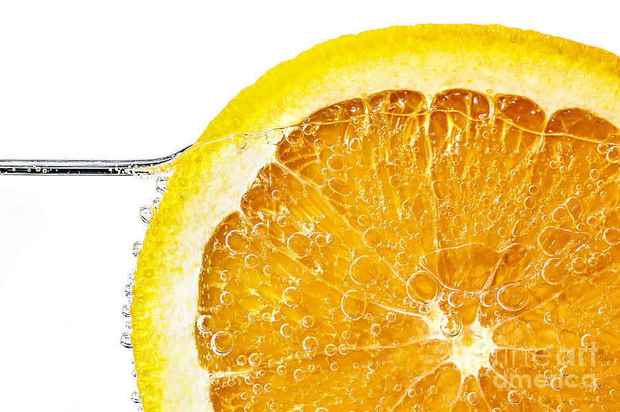 Orange Photograph - Orange Slice In Water by Elena Elisseeva
