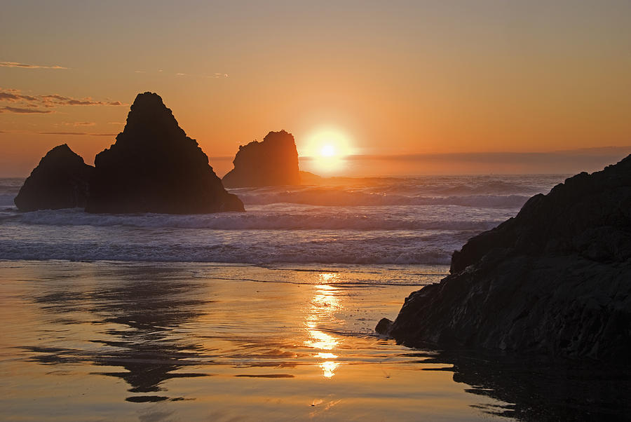 Beach Photograph - Orange Sunset Behind Offshore Rocks by Philippe Widling