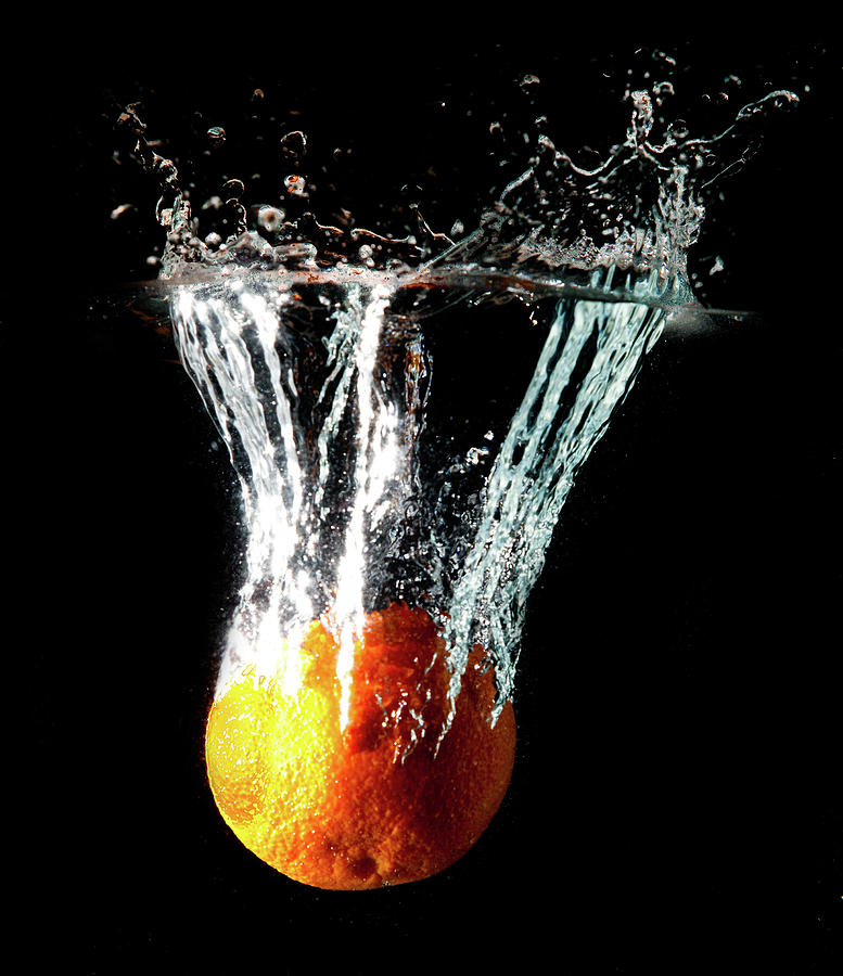 Orange Water Splash Photograph by Matthew Woitunski
