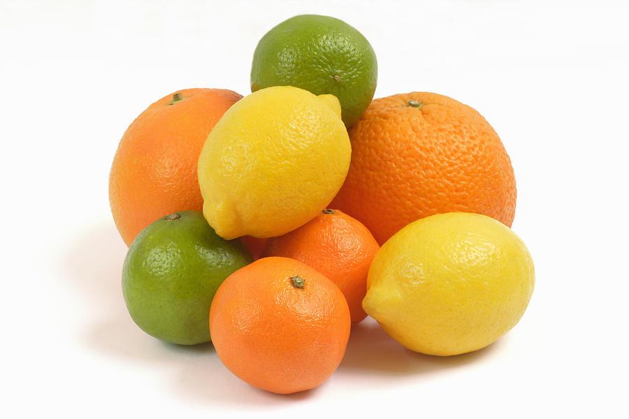 Oranges, lemons, limes and satsumas Photograph by Rosemary Calvert