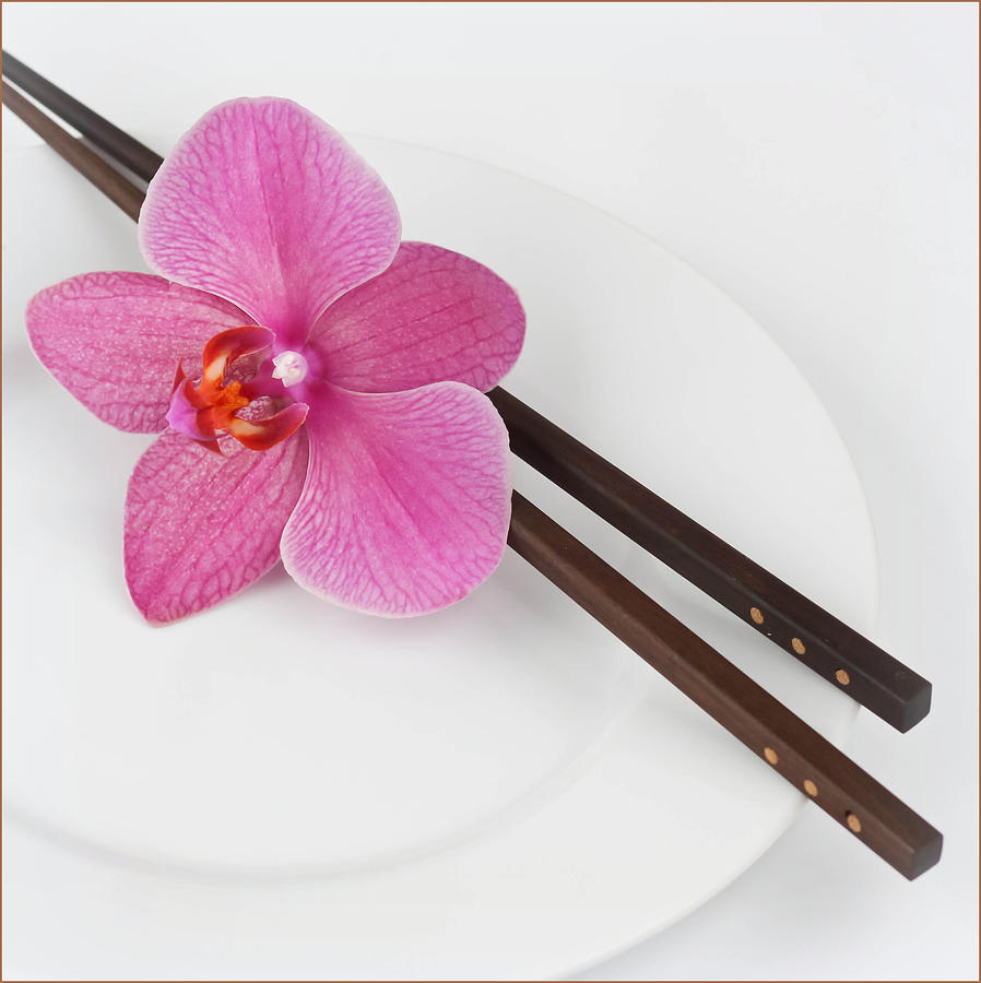 Orchid Flower On A Plate And Sushi Photograph by Ana Lukascuk