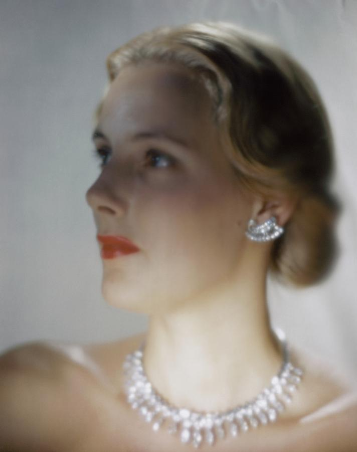 Out Of Focus Image Of A Model Wearing A Diamond Photograph by Erwin Blumenfeld