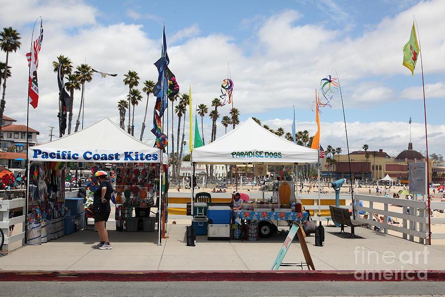 California Photograph - Pacific Coast Kites And Paradise Dogs On The Municipal Wharf At The Santa Cruz Beach Boardwalk Calif by Wingsdomain Art and Photography