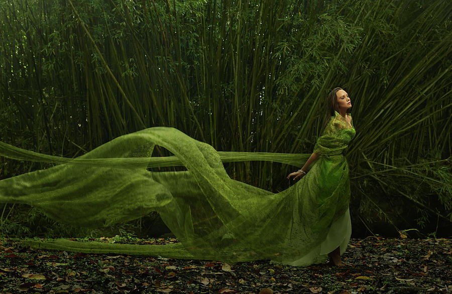 Pacific Islander Woman In Flowing Green Photograph by Colin Anderson Productions Pty Ltd