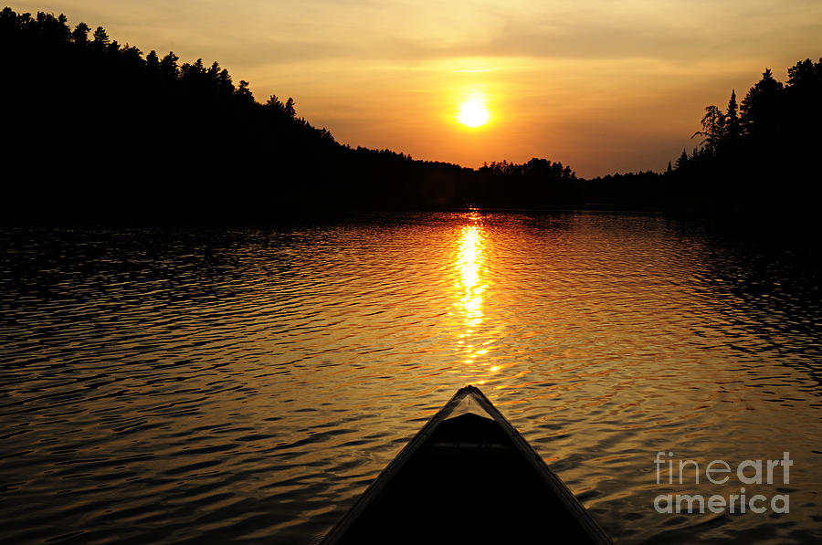Nature Photograph - Paddling Off Into The Sunset by Larry Ricker