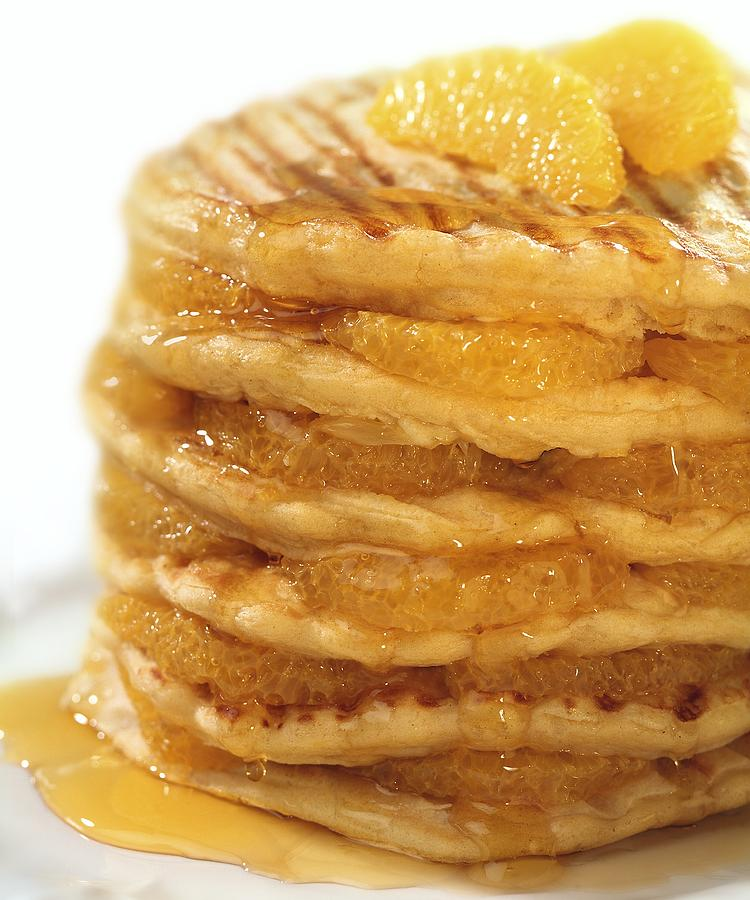 Citrus Sinensis Photograph - Pancakes With Oranges And Syrup by Science Photo Library