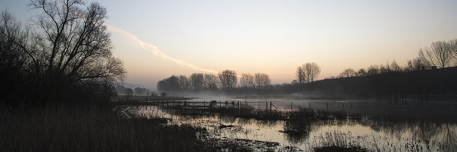 Landscape Photograph - Panorama Landscape Of Lake In Mist With Sun Glow At Sunrise by Matthew Gibson