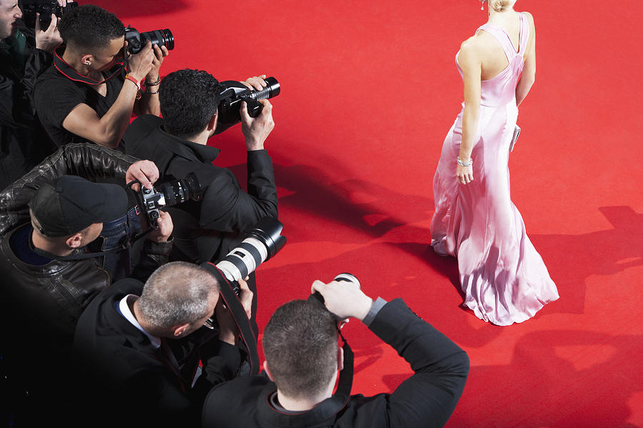 Paparazzi taking pictures of celebrity on red carpet Photograph by Robert Daly