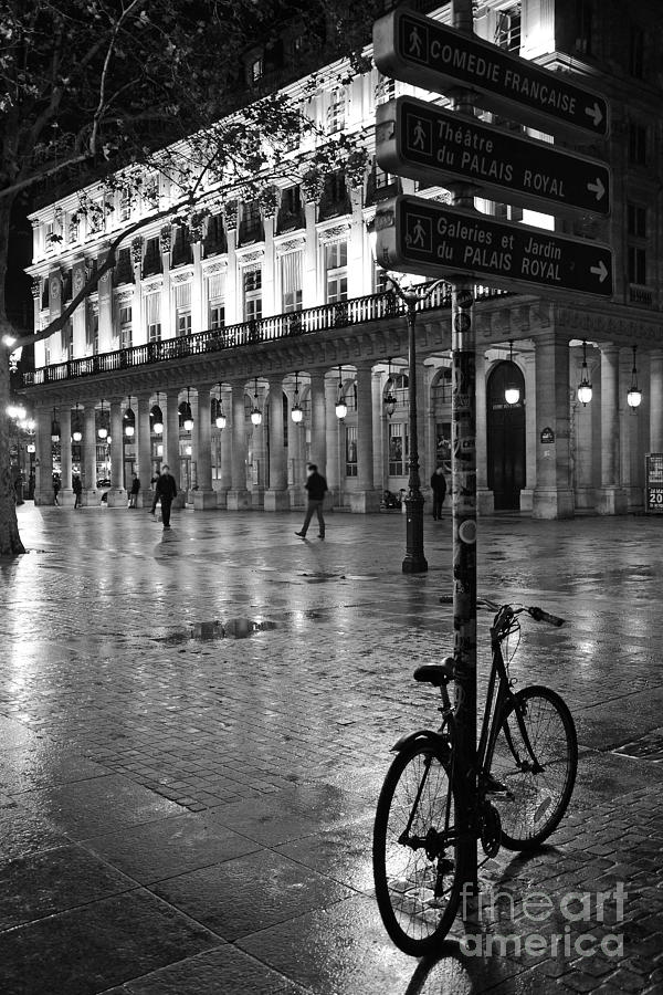 Paris night photography photograph paris black and white palais royal rainy night paris bicycle
