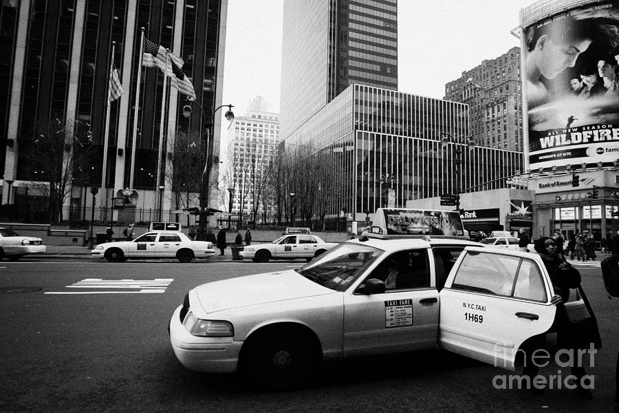 Usa Photograph - Passenger Gets Out Of Rear Door Of Yellow Taxi Cab On 7th Avenue New York City Usa by Joe Fox