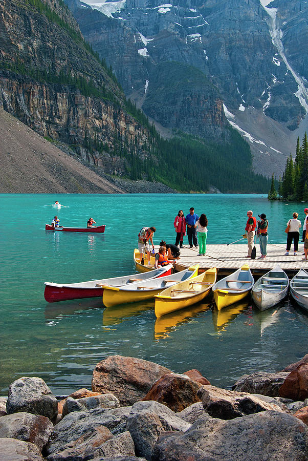Passengers Renting Colourful Canoes On Photograph by Emily Riddell