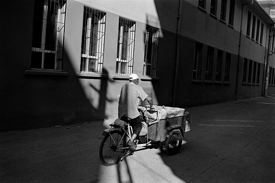 Street Photography Photograph - Passing Through Light by Ilker Goksen