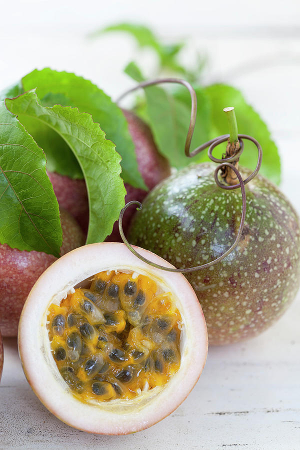 Passion Fruit On An Old Table Photograph by Enviromantic