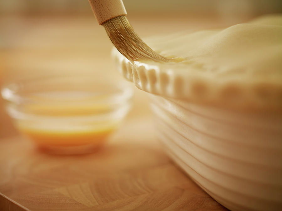 Pastry Being Brushed With Egg Wash Photograph by Adam Gault