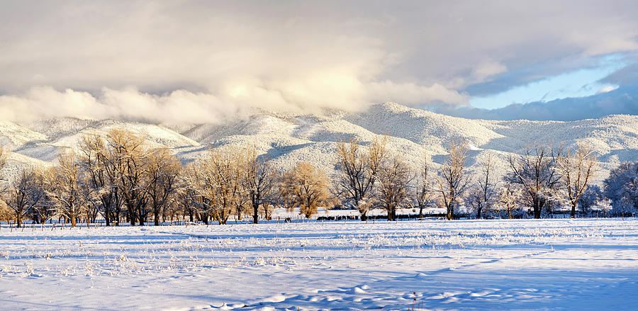 Color Image Photograph - Pasture Land Covered In Snow With Taos by Panoramic Images
