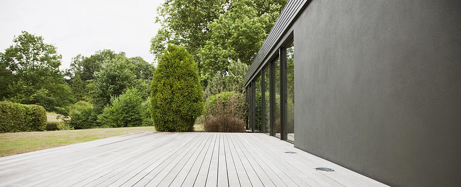 Patio and backyard of modern house Photograph by Tom Merton