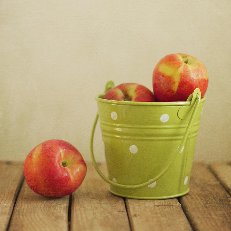 Peaches In Green Bucket With Polka Dots Photograph by Copyright Anna Nemoy(xaomena)
