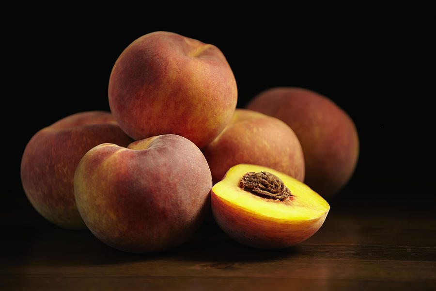Fresh Photograph - Peaches Sitting On A Wooden Table, One by Roderick Chen