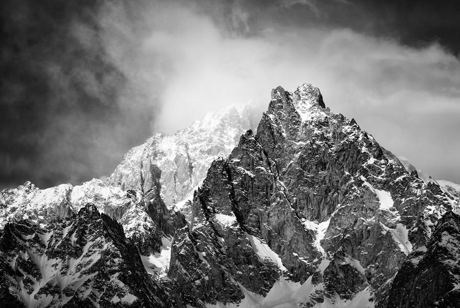 peaks in the clouds by Darko Ivancevic
