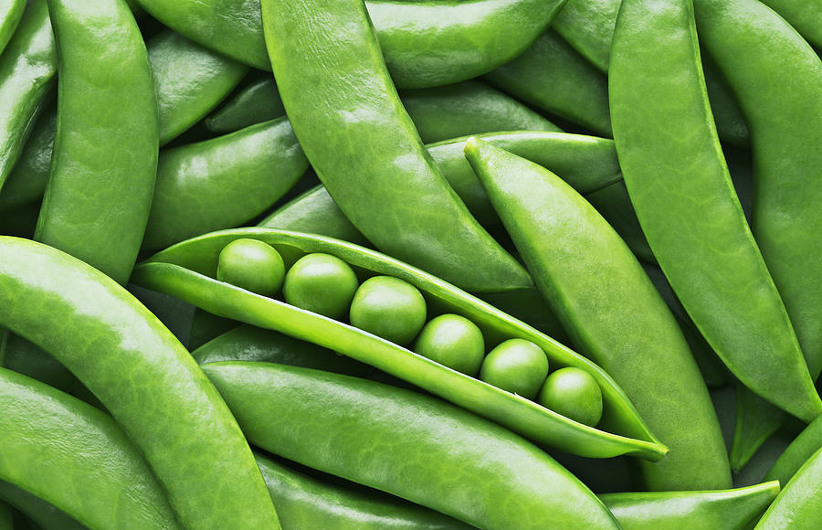 Peas and pea pods Photograph by Martin Barraud