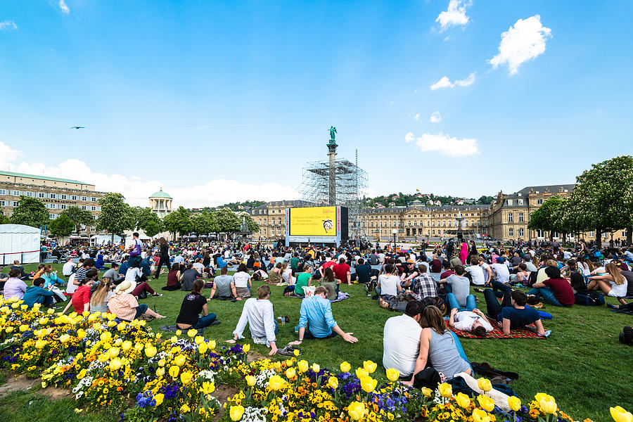 People Enjoying Open Air Cinema In The City Center Of