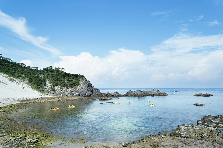 People Kayaking In Calm Cove Beach Photograph by Ippei Naoi