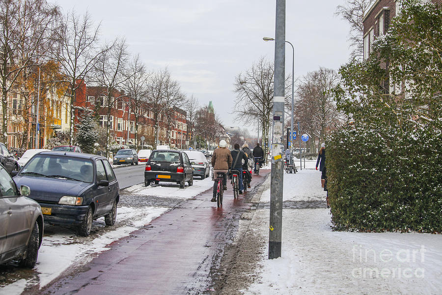 Dutch Photograph - People On Bicycles In Winter by Patricia Hofmeester