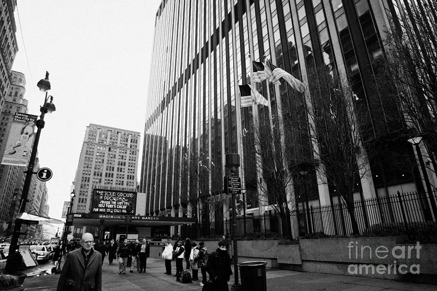 Usa Photograph - people on the sidewalk outside madison square garden with US flags flying new york city by Joe Fox