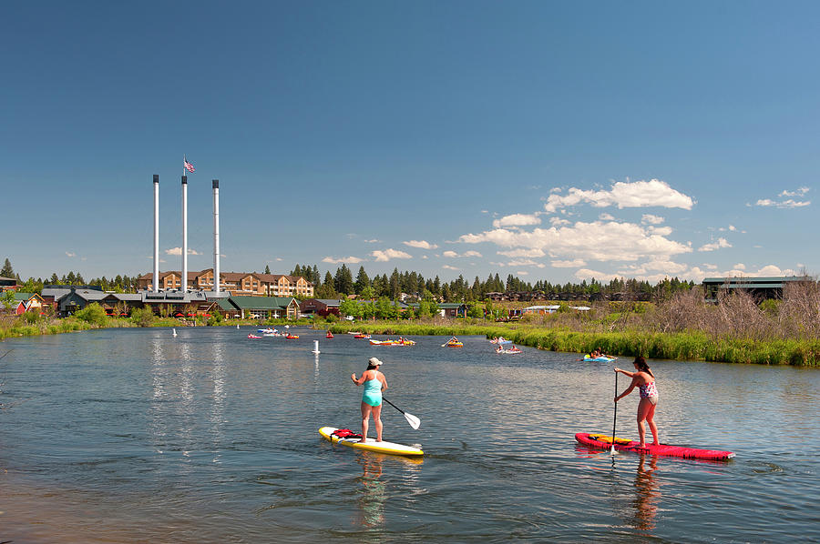 fd10cbe8fc People Paddle Boarding On The Deschutes by Christian Heeb