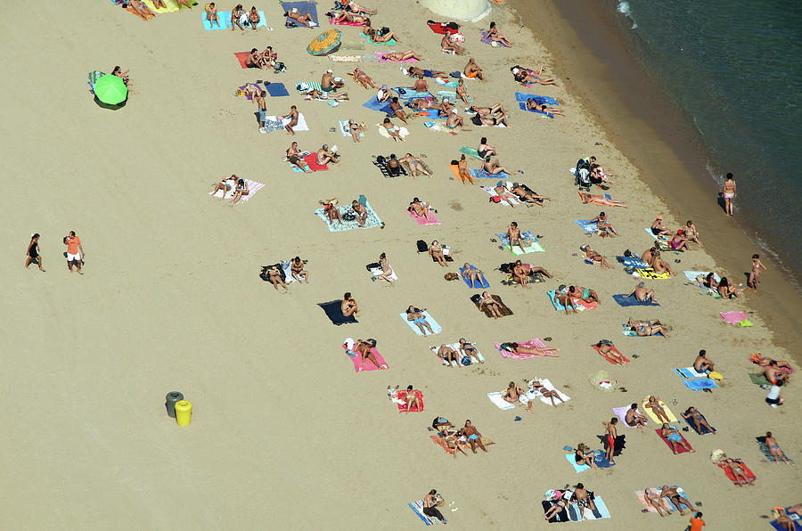 People Relaxing On Beach Photograph by Etienne Girardet