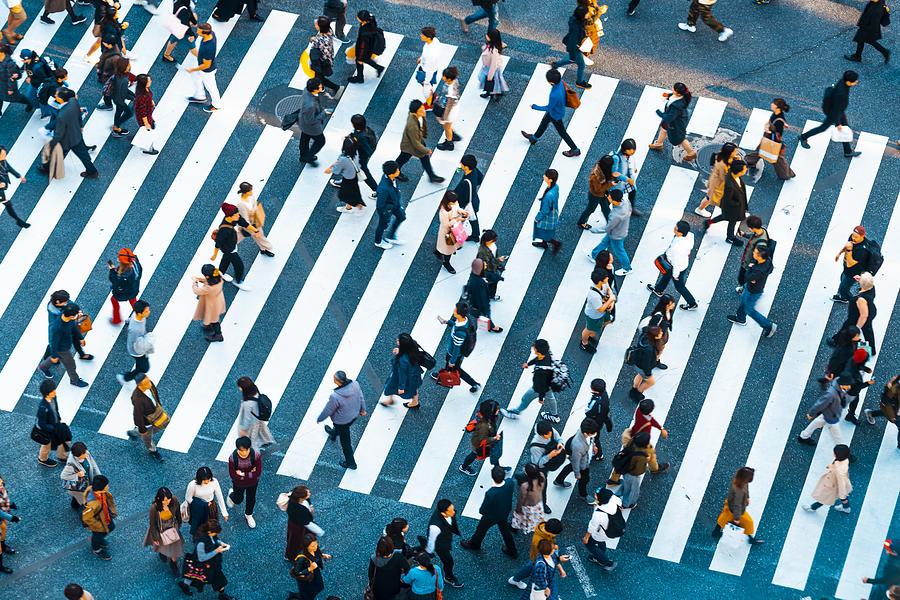 People walking at Shibuya crossing, Tokyo Photograph by © Marco Bottigelli