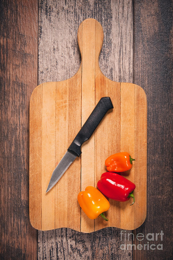 Food Photograph - Peppers And Knife On Cutting Board by Sharon Dominick