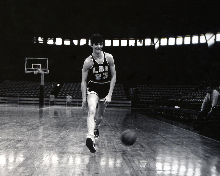 Classic Photograph - Pete Maravich Dribbling Between Legs by Retro Images Archive