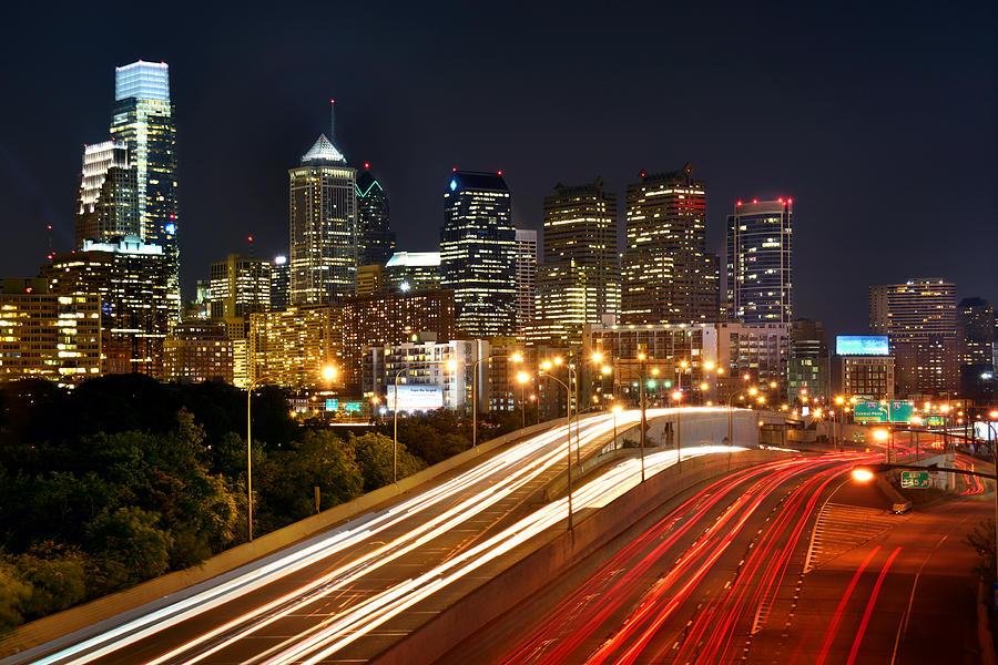 Philadelphia Skyline Photograph - Philadelphia Skyline At Night In Color Car Light Trails by Jon Holiday