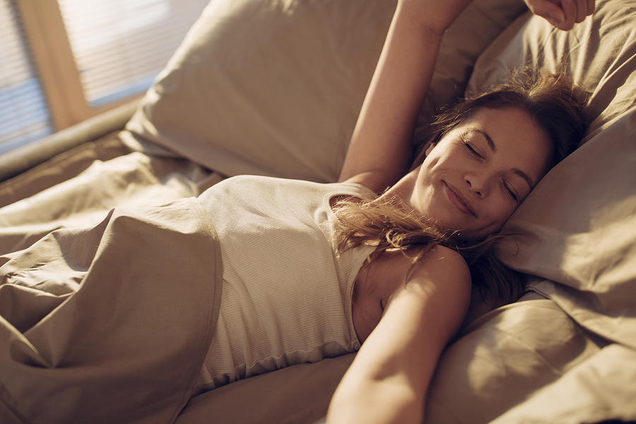Photo Of A Woman Waking Up Photograph by Geber86