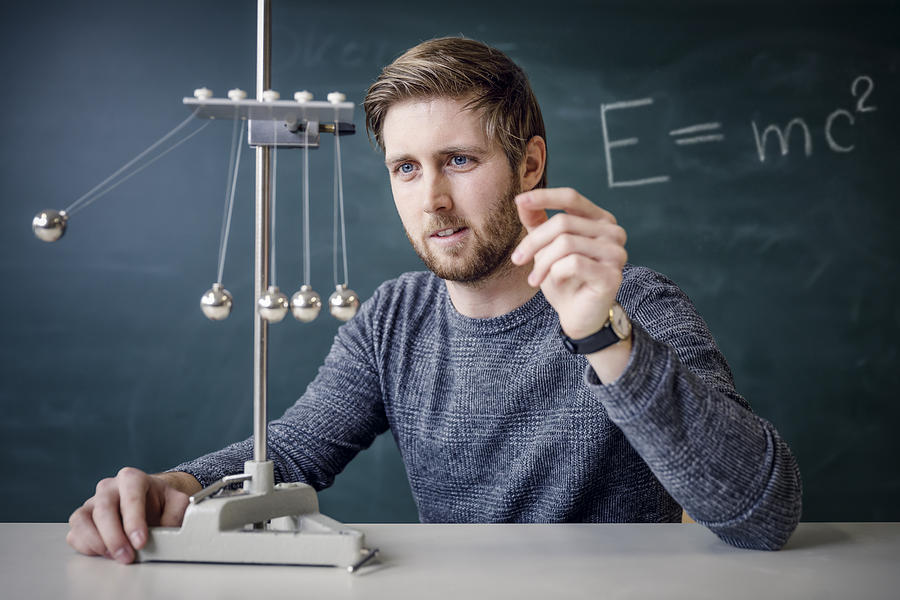 Physik Lehrer Mit Kugelstoßpendel Photograph by Martin Steinthaler