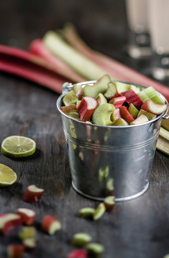 Pieces Of Rhubarb In Metal Bucket And Photograph by Westend61