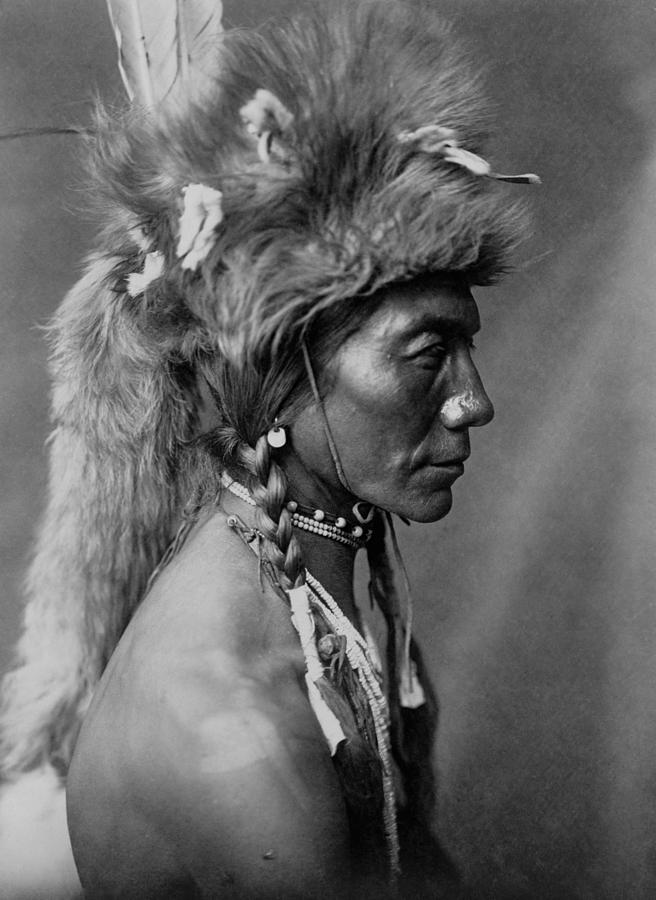 1910 Photograph - Piegan Indian Circa 1910 by Aged Pixel