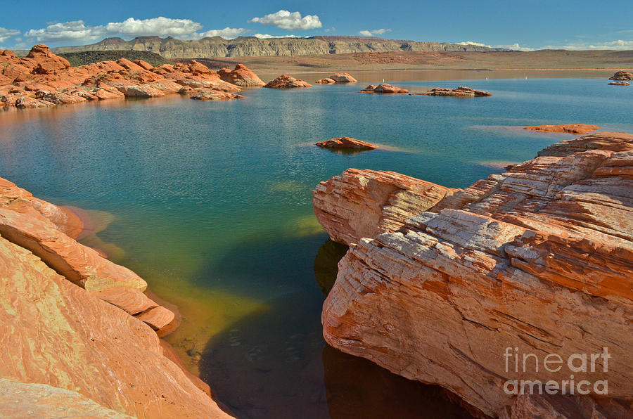 Pink rocks blue water by Jeff Loh