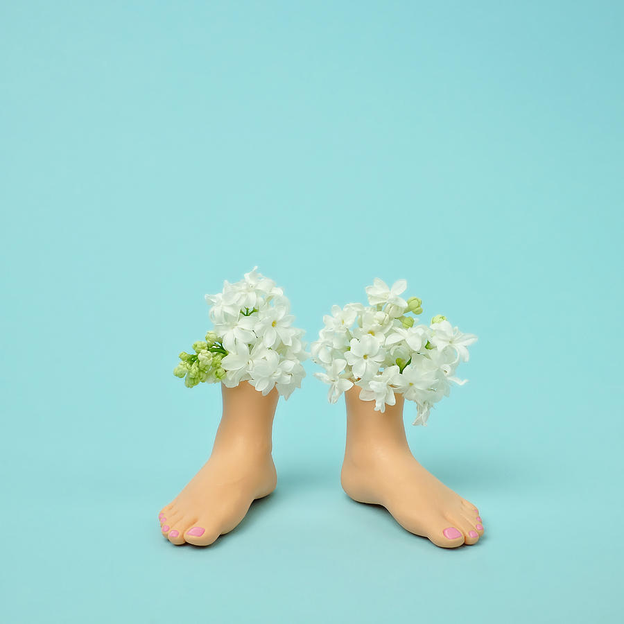 Plastic Feet Filled With Flowers Photograph by Juj Winn