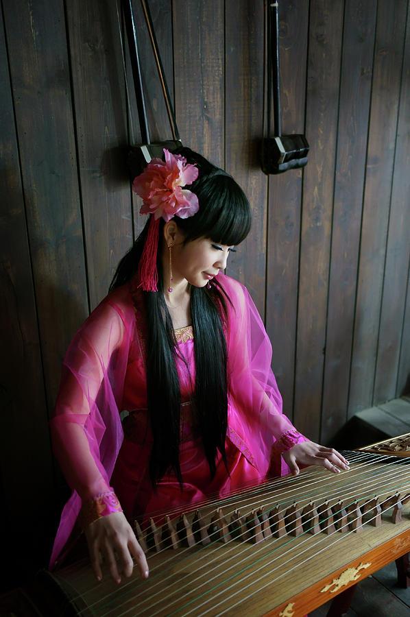 Playing Music Photograph by Anakin Tseng